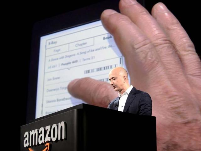 Jeff-Bezos-CEO-of-Amazon-introduces-new-Kindle-Paperwhite-during-a-press-conference-on-September-06-2012-in-Santa-Monica-California-AFP-Photo-Joe-Klamar