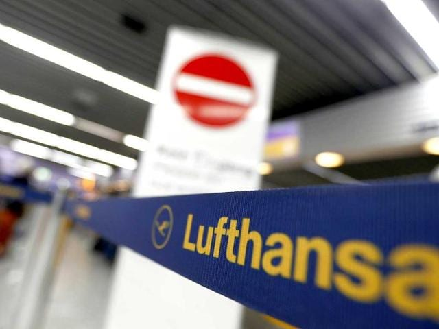 Passengers-wait-in-front-of-a-desk-of-German-air-carrier-Lufthansa-at-the-Fraport-airport-in-Frankfurt-Reuters-Photo