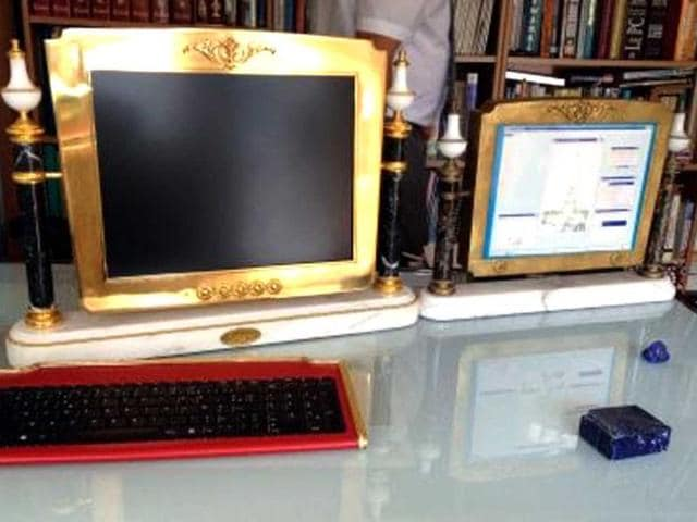 A-photo-shows-a-Louis-XVI-design-computer-assembled-by-Georges-Chirita-AFP-PHOTO-EMMANUELLE-TRECOLLE