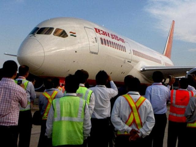 Airport-officials-admire-the-advanced-Boeing-787-Dreamliner-of-Air-India-that-touched-down-at-the-IGI-Airport-in-New-Delhi-PTI-Photo-by-Vijay-Verma