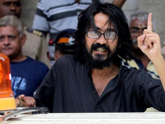 Kanpur-based-cartoonist-Aseem-Trivedi-who-was-arrested-on-charges-of-posting-seditious-contents-on-his-website-is-seen-outside-a-Mumbai-court-PTI