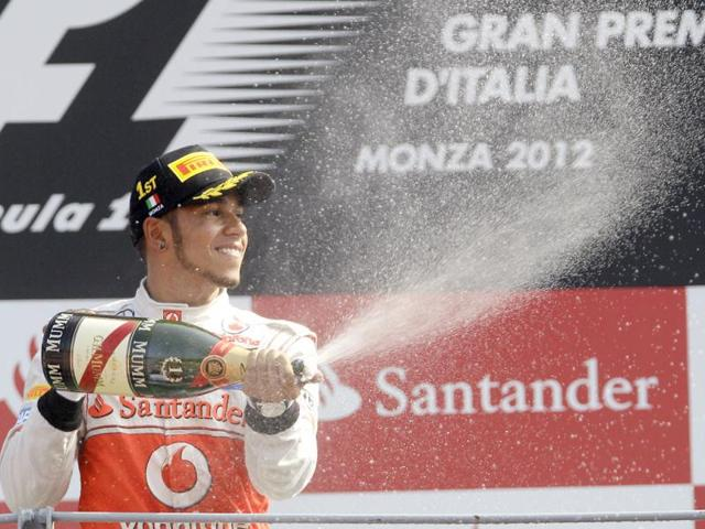 McLaren-Mercedes-driver-Lewis-Hamilton-of-Britain-celebrates-after-winning-the-Italian-Formula-One-GP-at-the-Monza-racetrack-in-Monza-Italy-AP-Photo-Antonio-Calanni