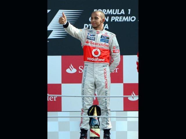McLaren-Mercedes-British-driver-Lewis-Hamilton-celebrates-on-the-podium-at-the-Autodromo-Nazionale-circuit-in-Monza-after-the-Italian-Formula-One-Grand-Prix-AFP-Photo-Olivier-Morin