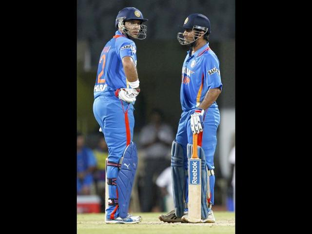 MS-Dhoni-and-Yuviraj-Singh-chat-between-two-overs-during-2nd-T20-match-played-between-India-and-New-Zealand-at-MA-Chidambaram-Stadium-in-Chennai-HT-Photo-Satish-Bate