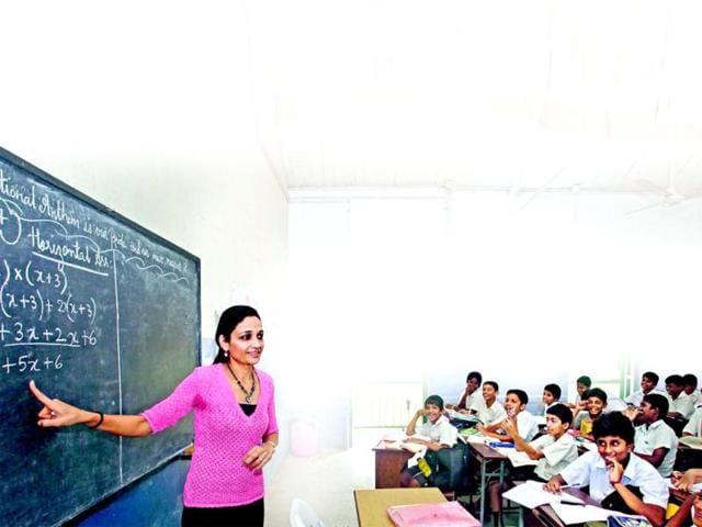 A-teacher-teaches-students-in-a-school-in-south-Mumbai