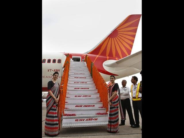 Air-India-flight-attendants-stand-at-the-base-of-stairs-during-the-unveiling-of-Air-India-s-first-Boeing-787-Dreamliner-HT-Sanjeev-Verma
