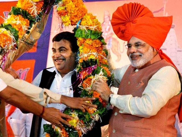 Nitin-Gadkari-is-presented-with-a-large-floral-garland-by-Gujarat-chief-minister-Narendra-Modi-PTI-Photo