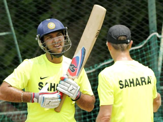 Yuvraj-Singh-listens-to-trainer-Trevor-Penney-during-a-practice-session-ahead-of-their-ICC-Twenty20-Cricket-World-Cup-match-against-Afghanistan-in-Colombo-AP-Eranga-Jayawardena