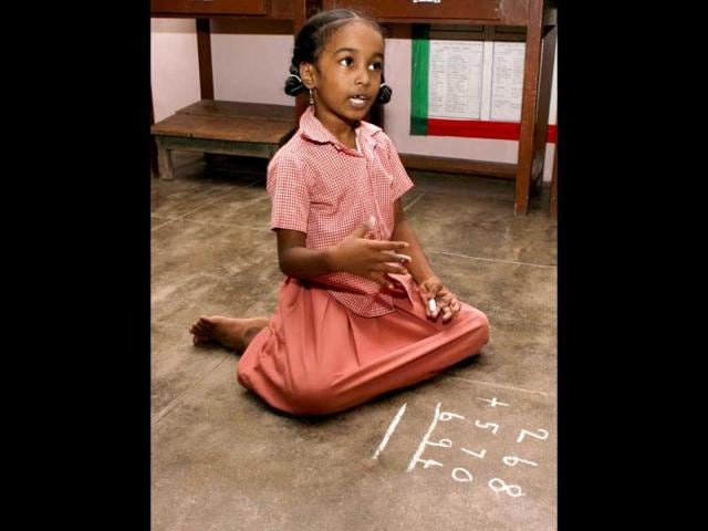 Children-use-the-abacus-number-rods-and-beads-to-learn-basic-arithmetic-at-the-the-Rani-Meyyammai-Primary-School-in-Adyar-Chennai-HT-Arun-Sankar