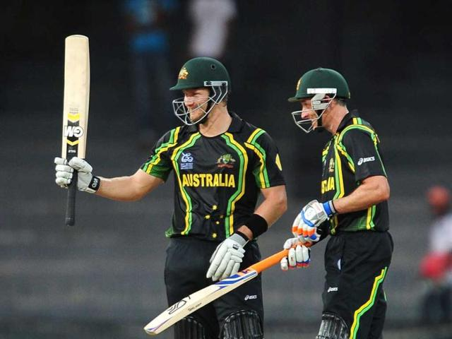 Shane-Watson-L-is-watched-by-his-teammate-Michael-Hussey-as-he-raises-his-bat-to-the-crowd-after-scoring-a-half-century-during-the-ICC-Twenty20-Cricket-World-Cup-match-between-Australia-and-Ireland-at-the-R-Premadasa-Stadium-in-Colombo-AFP-Photo