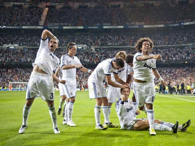 Real-Madrid-s-players-celebrate-after-scoring-their-second-goal-against-Manchester-City-during-a-Champions-League-Group-D-soccer-match-at-the-Santiago-Bernabeu-Stadium-in-Madrid-AP-Photo