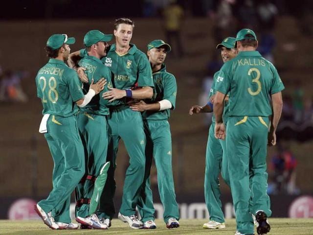 South-Africa-s-bowler-Morne-Morkel-third-left-celebrates-the-dismissal-of-Zimbabwe-s-captain-Brendan-Taylor-unsees-with-his-teammates-Jean-Paul-Duminy-third-trght-and-Robin-Pietersen-second-right-during-the-ICC-Twenty20-Cricket-World-Cup-match-between-South-Africa-and-Zimbabwe-in-Hambantota-AP-photo