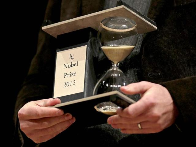 A-2012-Ig-Nobel-Prize-trophy-is-held-during-a-performance-at-the-Ig-Nobel-Prize-ceremony-at-Harvard-University-in-Cambridge-Massachusetts-AP-Photo-Charles-Krupa