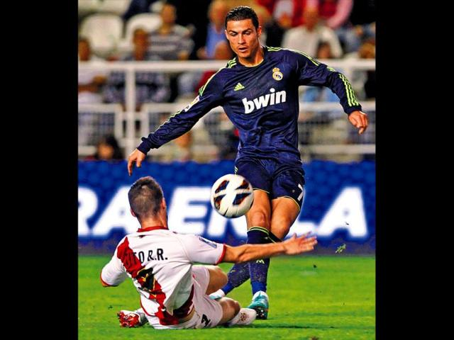 Real-Madrid-s-Cristiano-Ronaldo-vies-for-the-ball-with-Rayo-Vallecano-s-Tito-AP