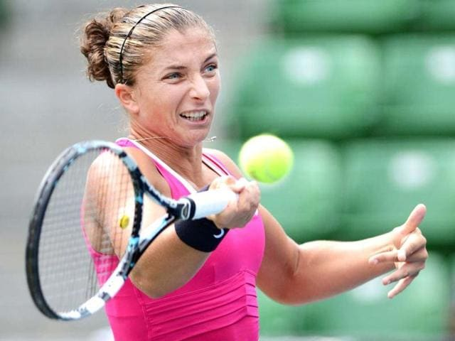 Sara-Errani-of-Italy-returns-a-shot-against-Marion-Bartoli-of-France-during-their-women-s-singles-third-round-match-at-the-Pan-Pacific-Open-tennis-tournament-in-Tokyo-AFP-Photo