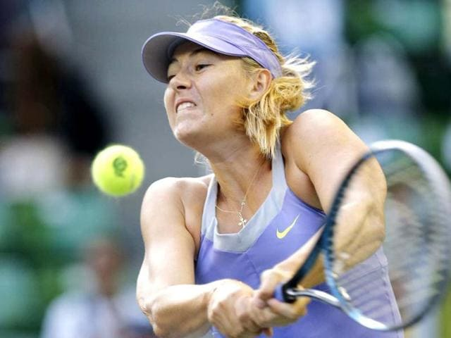 Maria-Sharapova-of-Russia-returns-a-shot-against-Lucie-Safarova-of-the-Czech-Republic-during-their-third-round-women-s-singles-match-at-the-Pan-Pacific-Open-tennis-tournament-in-Tokyo-Reuters