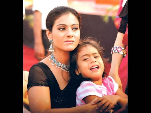In-terms-of-looks-Nysa-9-seems-to-have-taken-after-her-father-Ajay-Devgn-It-s-hard-to-say-who-Yug-2-looks-like-considering-he-s-still-a-baby-Kajol-has-often-said-that-Nysa-is-protective-about-her-little-brother