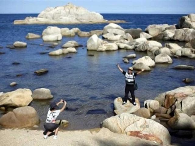 A-member-of-a-Chinese-delegation-takes-pictures-at-the-costal-area-of-the-Mount-Kumgang-resort-in-Kumgang-North-Korea-Reuters-Carlos-Barria