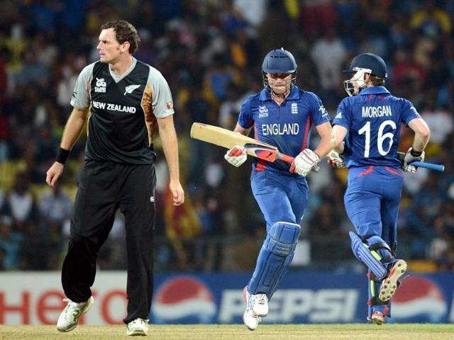 New-Zealand-bowler-Kyle-Mills-L-watches-as-England-batsmen-Luke-Wright-C-and-Eoin-Morgan-run-between-the-wickets-during-the-ICC-Twenty20-Cricket-World-Cup-s-Super-Eight-match-between-England-and-New-Zealand-at-The-Pallekele-International-Cricket-Stadium-in-Pallekele-AFP-Photo-Prakash-Singh