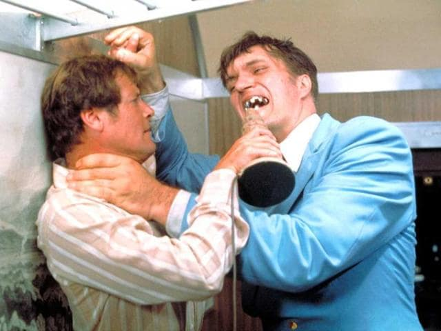 This-undated-publicity-photo-provided-by-United-Artists-and-Danjaq-LLC-shows-Richard-Kiel-right-as-Jaws-and-Roger-Moore-as-James-Bond-fighting-in-the-1977-film-The-Spy-Who-Loved-Me-Those-teeth-could-do-some-serious-damage-The-film-is-included-in-the-MGM-and-20th-Century-Fox-Home-Entertainment-Blu-Ray-Bond-50-anniversary-set-AP-Photo-United-Artists-and-Danjaq-LLC