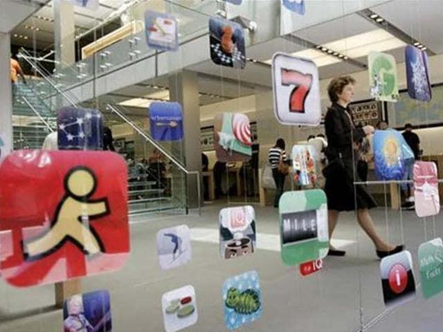 A-woman-walks-past-icons-for-Apple-applications-at-the-company-s-retail-store-in-San-Francisco-California-Credit-Reuters-Robert-Galbraith