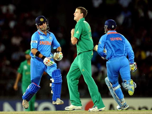 Gautam-Gambhir-L-and-Virender-Sehwag-R-run-between-the-wickets-as-South-African-cricketer-Morne-Morkel-C-looks-on-during-the-ICC-Twenty20-Cricket-World-Cup-s-Super-Eight-match-between-India-and-South-Africa-at-the-R-Premadasa-International-Cricket-Stadium-in-Colombo-AFP-Lakruwan-Wanniarachch