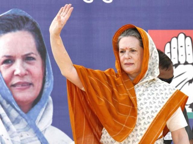 Congress-president-Sonia-Gandhi-with-party-s-Gujarat-chief-Arjun-Modhwadia-at-an-election-campaign-rally-in-Rajkot-PTI-photo