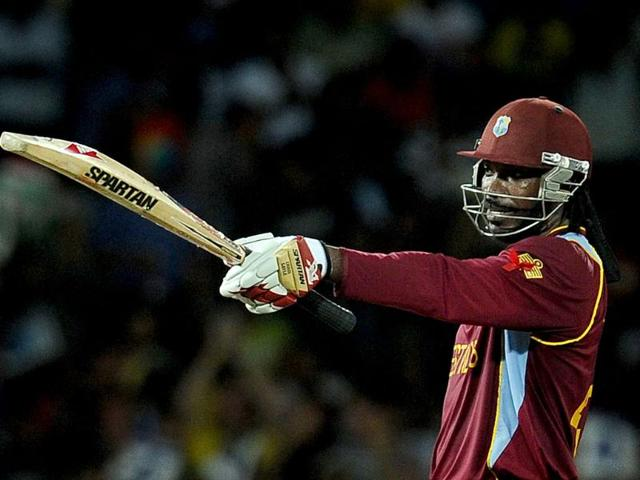 West-Indies-cricketer-Chris-Gayle-raises-his-bat-to-the-crowd-after-scoring-a-half-century-during-the-ICC-Twenty20-Cricket-World-Cup-s-semi-final-match-in-Colombo-AFP-Photo-Lakruwan-Wanniarachchi