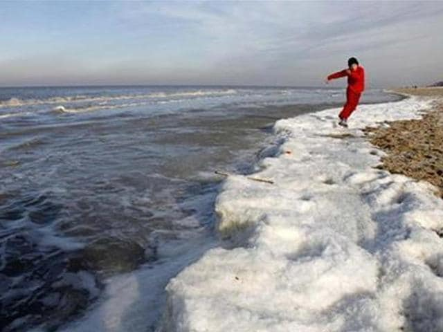 A-boy-runs-on-the-frozen-seaside-in-the-beach-of-De-Haan-near-Brugge-in-Belgium-Credit-Reuters-Pascal-Rossignol