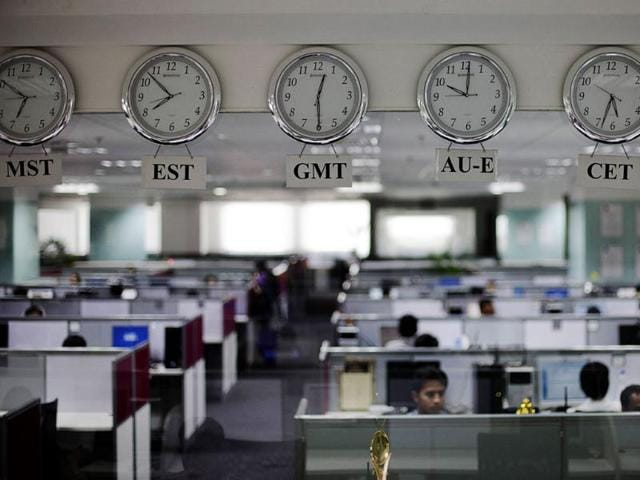 Workers-are-pictured-beneath-clocks-displaying-time-zones-in-various-parts-of-the-world-at-an-outsourcing-centre-in-Bangalore-Reuters-Vivek-Prakash