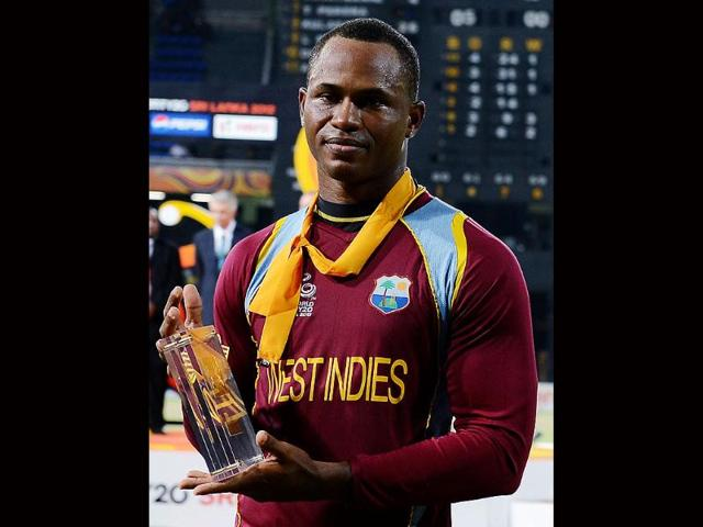 West-Indies-cricketer-Marlon-Samuels-with-his-good-luck-neckerchief-holds-the-Man-of-The-Match-prize-after-victory-in-the-ICC-Twenty-Cricket-World-Cup-s-final-match-between-Sri-Lanka-and-West-Indies-in-Colombo-AFP-Lakruwan-Wanniarachchi