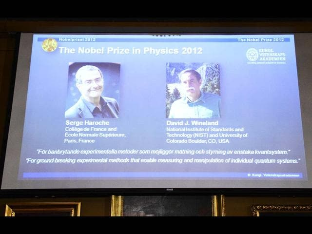 Pictures-of-Serge-Haroche-France-and-David-Wineland-US-are-projected-on-a-screen-at-the-Royal-Swedish-Academy-of-Science-in-Stockholm-AFP-PHOTO