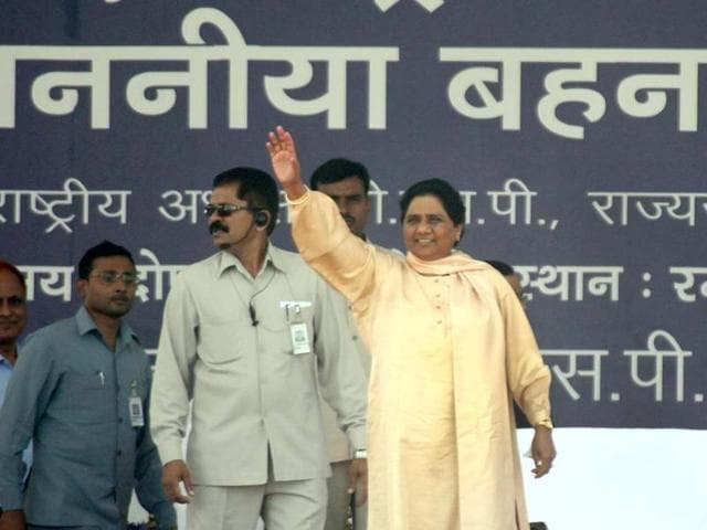 Bahujan Samaj Party supremo Mayawati waves to supporters during a rally commemorating the sixth death anniversary of party founder Kanshiram in Lucknow. AFP
