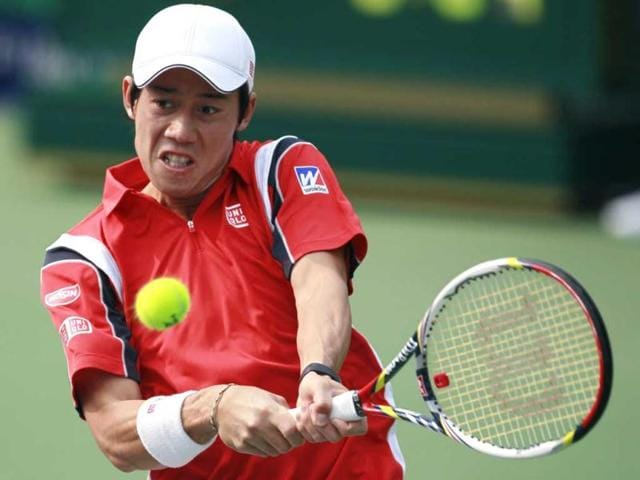 Kei-Nishikori-of-Japan-returns-the-ball-to-Sam-Querrey-of-the-US-during-their-men-s-singles-match-in-the-Shanghai-Masters-tennis-tournament-in-Shanghai-Reuters-Aly-Song