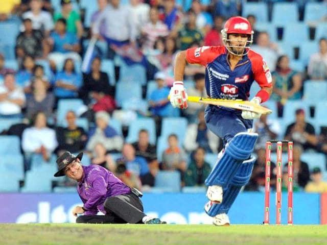 St-Stephen-s-college-principal-Valson-Thampu-felicitates-under-19-cricket-captain-Unmukt-Chand-on-Tuesday-Raj-k-Raj-HT-photo