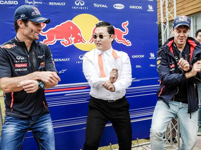 K-Pop-star-Psy-performs-the-Gangnam-style-dance-with-Red-Bull-Renault-driver-Mark-Webber-of-Australia-and-Red-Bull-Renault-driver-Sebastian-Vettel-of-Germany-before-the-start-of-the-Formula-One-Korean-Grand-Prix-at-the-Korean-Circuit-in-Yeongam-AFP-Philippe-Lopez