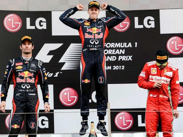 Winner-Red-Bull-Renault-driver-Sebastian-Vettel-of-Germany-reacts-on-the-podium-next-to-second-placed-Red-Bull-Renault-driver-Mark-Webber-of-Australia-and-third-placed-Ferrari-driver-Fernando-Alonso-of-Spain-after-winning-the-Formula-One-Korean-Grand-Prix-at-the-Korean-Circuit-in-Yeongam-AFP-Philippe-Lopez