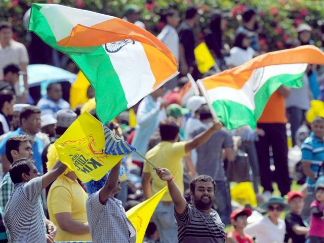 Cricket-fans-wave-flags-during-a-Group-B-match-of-the-Champions-League-T20-between-the-Chennal-Super-Kings-and-the-Sydney-Sixers-at-the-Wanderers-Stadium-in-Johannesburg-AFP-photo