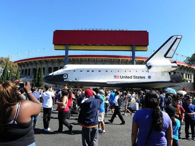 The-Space-Shuttle-Endeavour-passes-the-Los-Angeles-Memorial-Coliseum-as-it-arrives-at-the-end-of-its-journey-to-the-California-Science-Center-in-Exposition-Park-in-Los-Angeles-Photo-AFP-Robyn-Beck