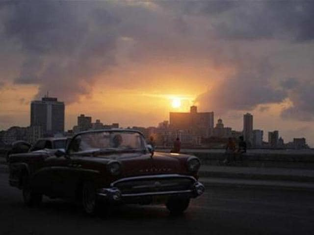 A-car-is-driven-on-Havana-s-seafront-boulevard-El-Malecon-at-sunset-Credit-Reuters-Desmond-Boylan