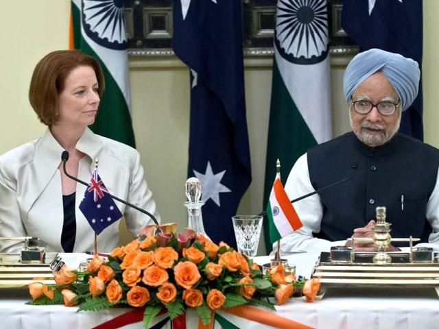 Australian-Prime-Minister-Julia-Gillard-watches-as-Prime-Minister-Manmohan-Singh-delivers-his-statement-after-an-agreement-signing-in-New-Delhi-AFP-Photo