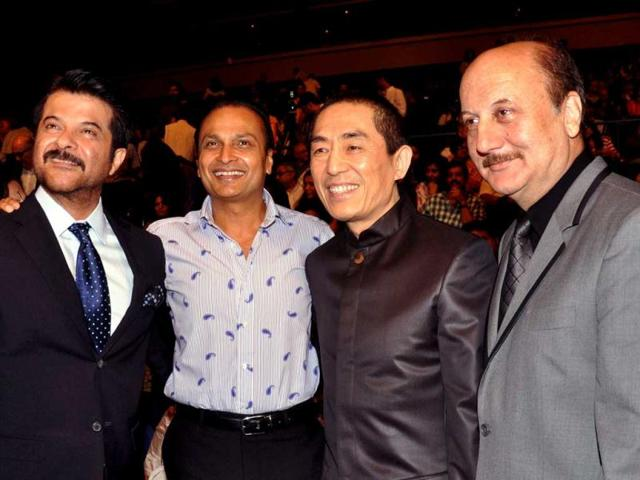 Bollywood-actors-Anil-Kapoor-L-and-Anupam-Kher-R-pose-with-industrialist-Anil-Ambani-2L-and-Chinese-Director-Zhang-Yimou-2R-as-they-attend-the-opening-ceremony-for-the-14th-Mumbai-Film-Festival-in-Mumbai-late-October-18-2012-AFP-PHOTO