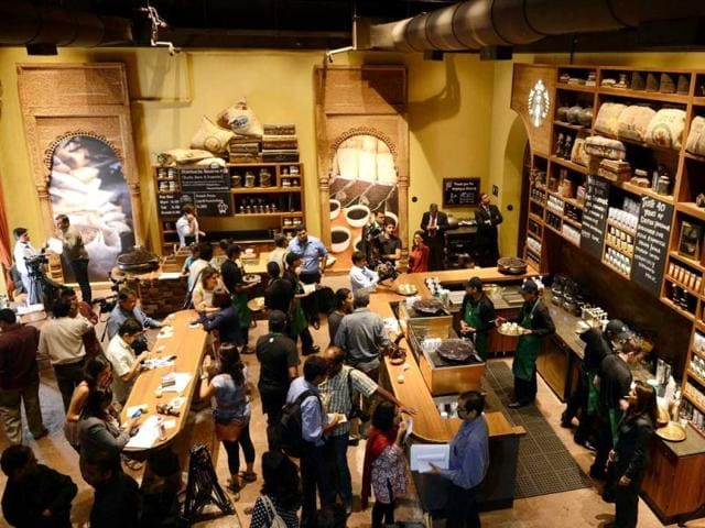 Staff-work-behind-the-counter-of-India-s-first-newly-inaugurated-Starbucks-outlet-in-Mumbai-Starbucks-the-world-s-biggest-coffee-chain-launched-its-first-Indian-outlet-in-an-upscale-part-of-Mumbai-becoming-the-latest-global-firm-to-tap-the-urban-youth-s-growing-taste-for-caffeine-AFP-Punit-Paranjpe