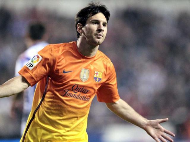 FC-Barcelona-s-Lionel-Messi-from-Argentina-celebrates-his-goal-during-a-Spanish-La-Liga-soccer-match-against-Deportivo-la-Coruna-at-the-Riazor-stadium-in-La-Coruna-Spain-AP-Photo