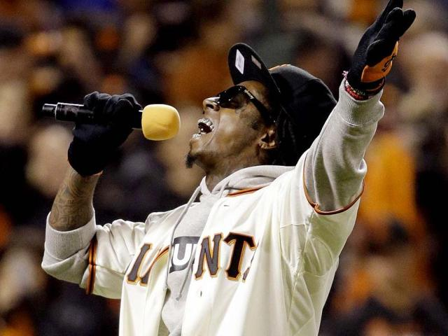 Entertainer-Lil-Wayne-sings-Take-Me-Out-To-The-Ball-Game-during-the-seventh-inning-of-Game-6-of-baseball-s-National-League-championship-series-between-the-San-Francisco-Giants-and-the-St-Louis-Cardinals-in-San-Francisco-AP-Photo
