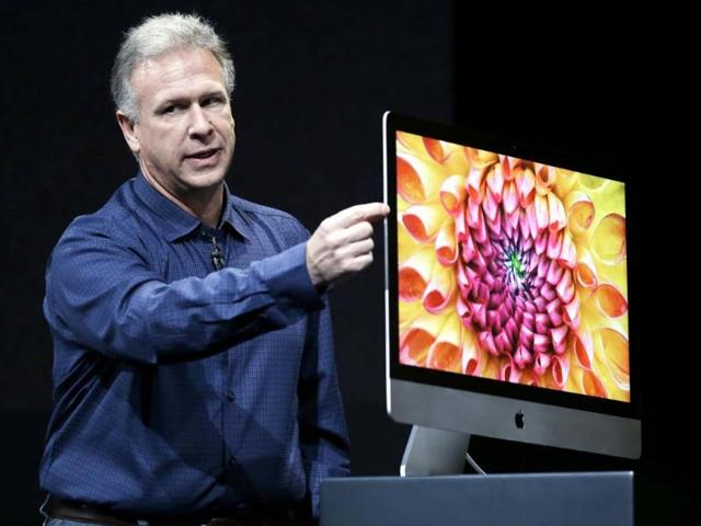 Phil-Schiller-Apple-s-senior-vice-president-of-worldwide-product-marketing-talks-about-the-thinness-of-the-new-iMac-in-San-Jose-California-AP-Photo
