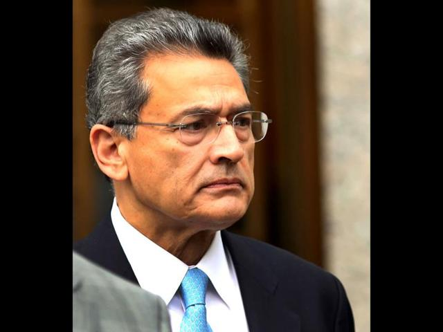 Rajat Gupta, former Goldman Sachs Inc. director and former senior partner at McKinsey & Co., exits Federal court after being sentenced to two years in prison in New York. AP photo
