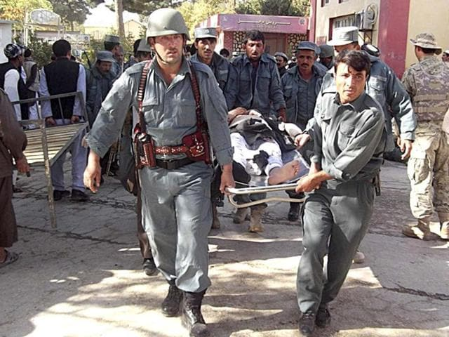 Afghan-policemen-carry-the-body-of-a-civilian-after-a-bomb-blast-in-Faryab-province-A-suicide-bomber-killed-at-least-40-people-in-a-mosque-in-Afghanistan-s-relatively-peaceful-north-on-Friday-as-worshippers-gathered-for-prayers-marking-the-Muslim-Eid-al-Adha-holiday-police-officials-said-REUTERS