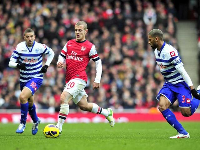 Arsenal-s-midfielder-Jack-Wilshere-2nd-L-vies-with-Queens-Park-Rangers-French-born-Senegalese-defender-Armand-Traore-R-and-Moroccan-midfielder-Adel-Taarabt-L-during-the-English-Premier-League-football-match-between-Arsenal-and-Queens-Park-Rangers-at-The-Emirates-Stadium-in-north-London-England-AFP-Photo