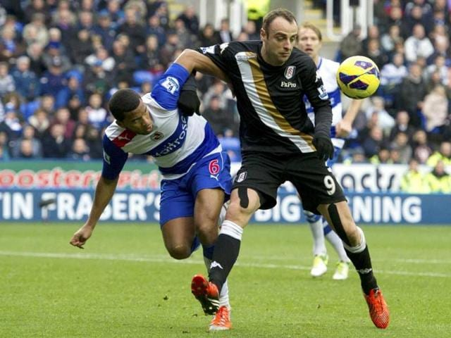Reading-s-Adrian-Mariappa-left-challenges-Fulham-s-Dimitar-Berbatov-during-their-English-Premier-League-soccer-match-at-the-Madjeski-stadium-in-Reading-England-AP-Photo